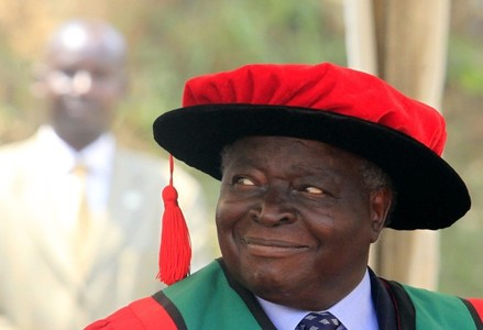 Kenya's President Mwai Kibaki looks on after receiving the Honorary Doctor of Laws degree from Makerere University, during their 62nd graduation ceremony at the University's grounds in Kampala January 24, 2012. Kibaki was presented the doctorate to recognise his contribution to public service, academic excellence as well as political, social and economic reform, according to local media. REUTERS/James Akena (UGANDA - Tags: POLITICS EDUCATION)